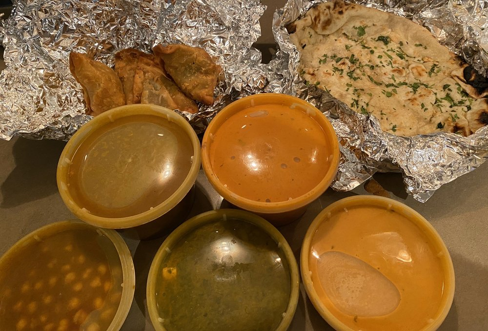 Vegetarian platter, lamb curry, butter chicken, samosas, garlic naan