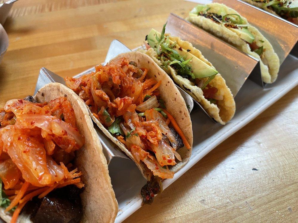 Korean short ribs and tuna poke tacos